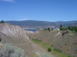 I ride up a hill so I can look down and take a picture of Okanagan Lake at the North end of town