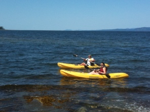 in the ocean with a paddle