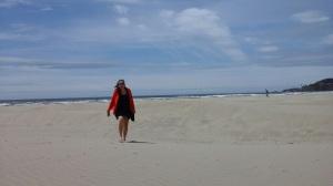 sand between her toes