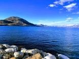 Okanagan lake, still snow at high altitude